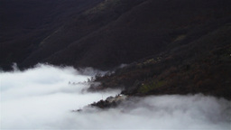 Timelapse scenery with fog over mountain slope Footage