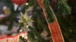 Gold Star Ornament Hanging on a Christmas Tree Footage