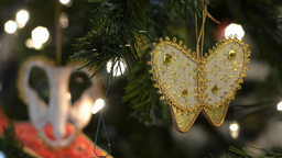Closeup of Butterfly Christmas Tree Ornaments Footage