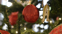 Red Bauble and Decorations on a Christmas Tree Footage