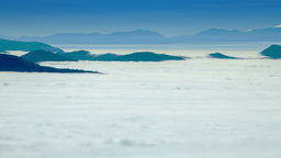 Mountain peaks with dense layer of fog, timelapse Footage