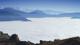 Timelapse scenery with layer of fog among mountain Footage