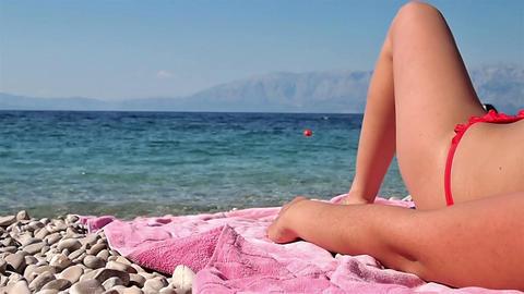 Woman lying on the beach Footage
