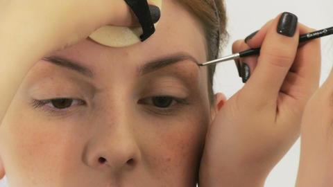 Woman having make up in beauty salon Footage