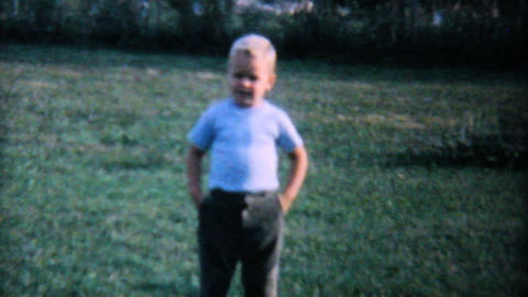 Cute Little Boy Standing In The Backyard 1962 Footage