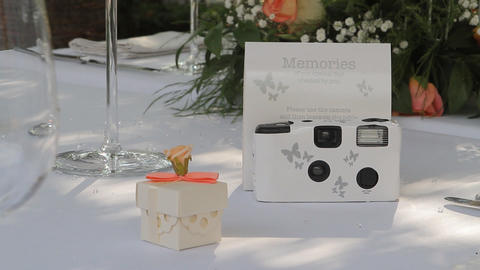 Disposable White Wedding Camera On A Wedding Table stock footage