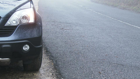Car Needs Help on Foggy Winter Road 1 Footage