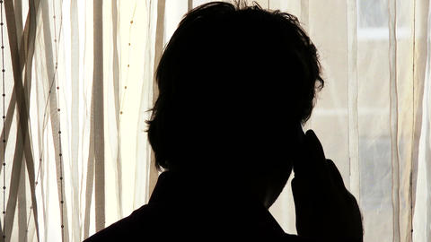 Man Behind Curtain Talking Phone Silhouette 1 Footage