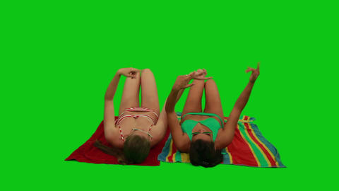 Girls Lying On The Towel And Dancing With Their Ha stock footage