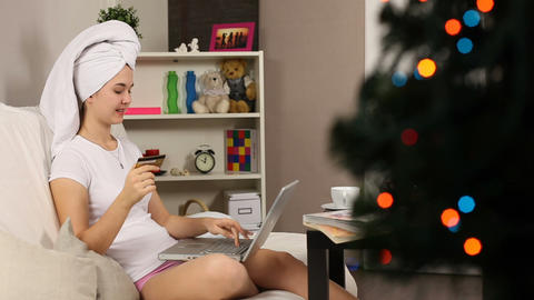 Girl bying on-line at Christmass Eve Footage