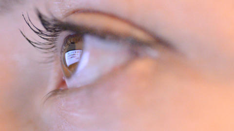 Women Eye With Reflection Of Surfing Internet At N stock footage