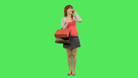 Female callling and holding shopping bags Footage