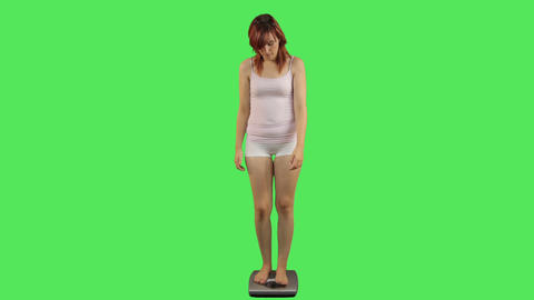 Female on weight scale Footage