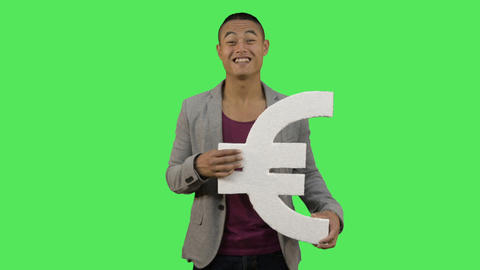 Male holding euro symbol Live Action