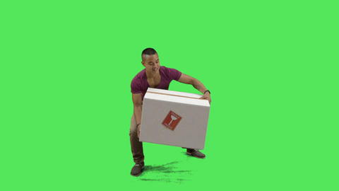 Young adult carrying box for delivery Footage