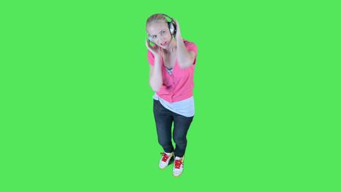 Female listening to music on headphones Footage