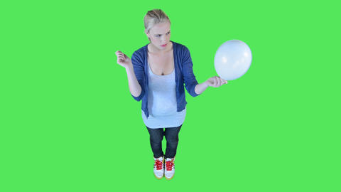 Female Putting Needle In Balloon stock footage
