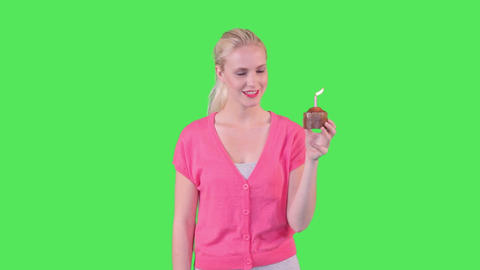 Female holding cupcake Footage