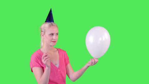 Female Sticking Needle In Balloon stock footage