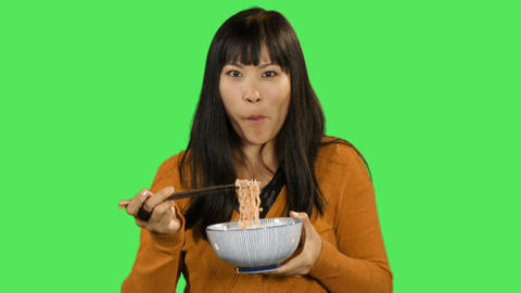 Asian female eating noodles Footage