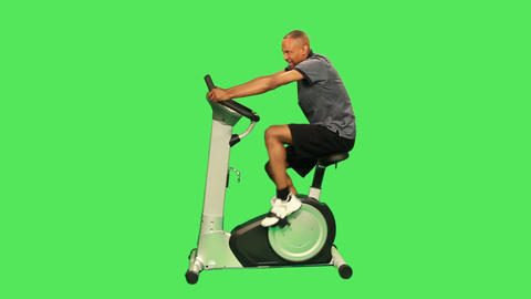 Male Training On Exercise Bicycle stock footage