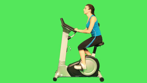 Female Training On Exercise Bicycle stock footage