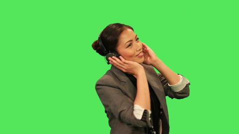 Asian female listening to music Footage