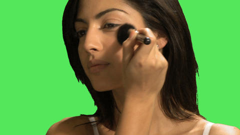 A young woman applying blusher Footage