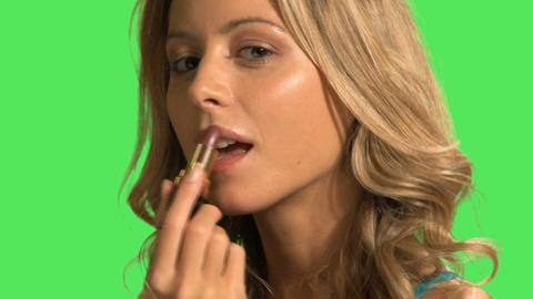 A young woman applying lipstick Footage