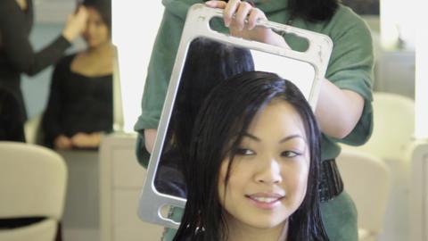 Woman having hair cut in hair salon Footage