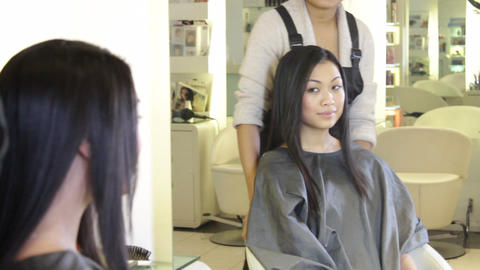 Hairdresser showing to customer hair cut Live Action