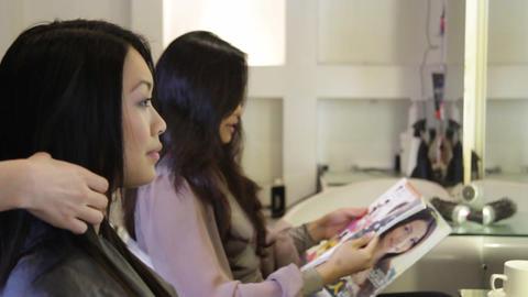 Females sitting in hair salon chatting Footage