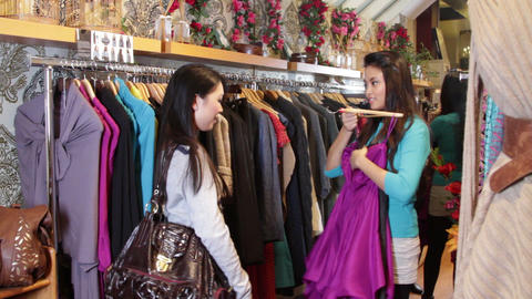Females looking in clothes shop at clothes Live Action