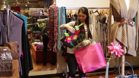 Female walking around in clothes shop Live Action