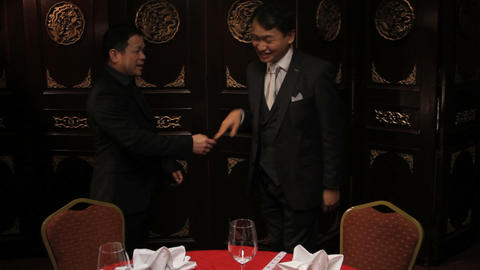 Businessmen meeting and shaking hands in Chinese restaurant Footage