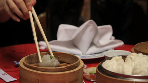 Close up of female eating dim sum in Chinese restaurant Footage
