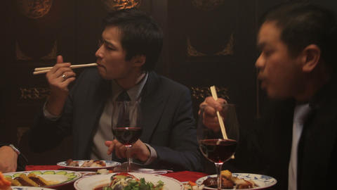 Businessmen eating in Chinese restaurant Footage