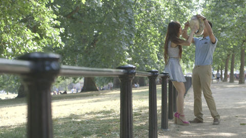 Young couple walking in park Footage