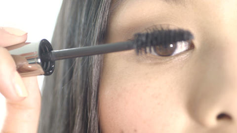 Young woman applying black mascara Footage
