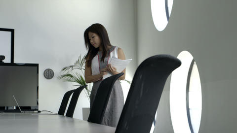 Businesswoman placing document on conference table Footage