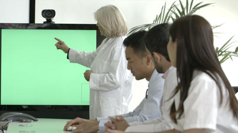 Female doctor explaining with projection equipment in meeting room Footage