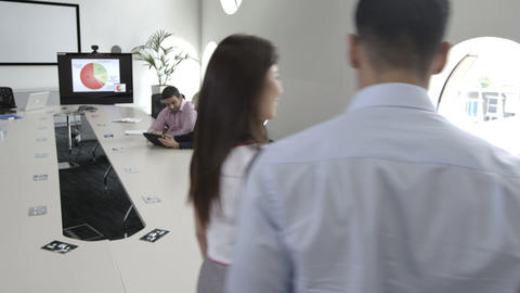Business people greeting in conference room Footage
