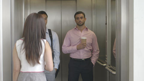 Woman with disposable cup and entering in lift Footage