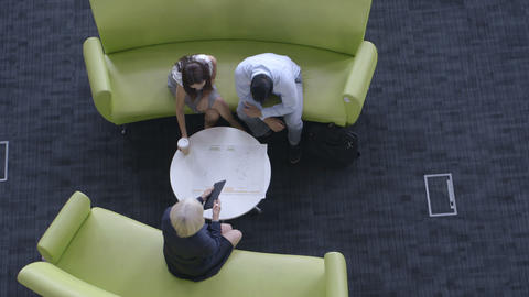 Businessman and woman having meeting in office Footage