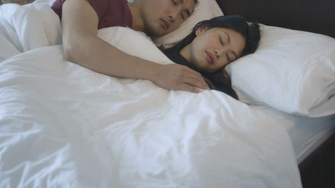 Couple sleeping on bed in bedroom Footage