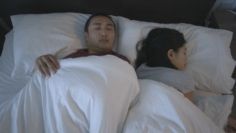 Couple Sleeping On Bed stock footage