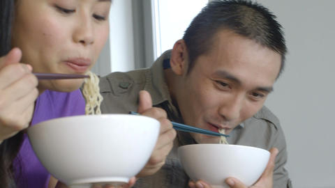 Young couple eating noodles Footage