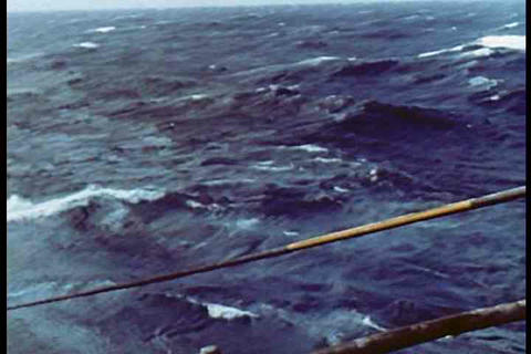 A ship lays underwater cables in 1950 Footage