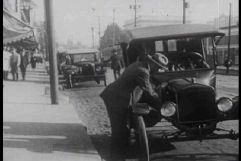 A silent film shows bad driving and people rushing Footage