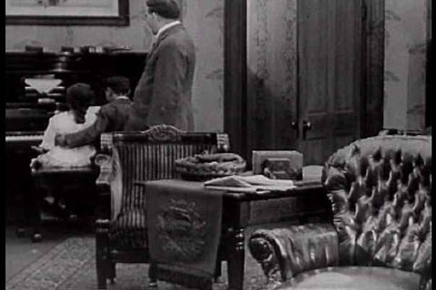 Dad leads a happy home life in 1925 silent film Footage